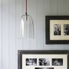 with a red braided flex and clear glass shade this wonderfully simple pendant light is