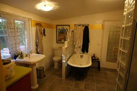 glass block shower passing on paradise wall separates toilet and