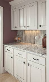 small tile backsplash in kitchen small kitchen ideas white granite countertop white kitchen