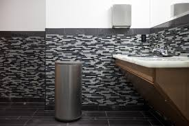 decorating modern bathroom design with trash can and tile wall