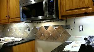 How To Put Up Kitchen Backsplash by Backsplash Behind Stove Youtube