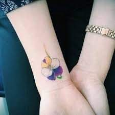 picture of yellow white purple and green flower tattoo