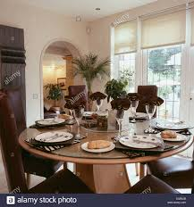 modern circular table set for lunch in traditional dining room