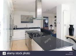 kitchen island extractor extractor fan above hob in black granite island unit in modern