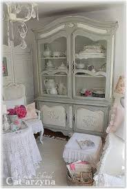makeover for a plain armoire by adding embellishments and then