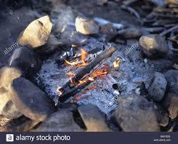 cinder outside dusk twilight fire flames glow wood campfire stones