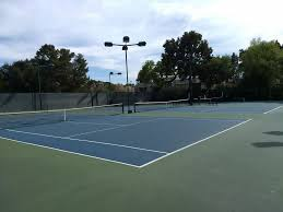 lighted tennis courts near me three lighted tennis courts with benches but no partitions yelp