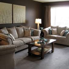 Comfy Sectional Sofa by Dark Brown Varnished Coffee Table Come With Cream Armchair And