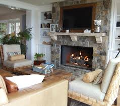 fireplace stone veneer living room beach with armchairs built in