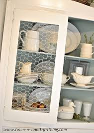 town and country cabinets summer farmhouse decorating tips cabinet fronts chicken wire and