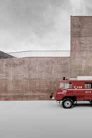 pedevilla architects creates rose hued fire station for alpine