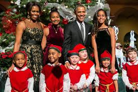 family christmas malia and sparkle in the obama family s new christmas card