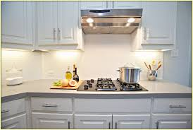 cream glass subway tile with cream kitchen counter top also