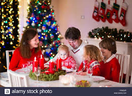 big family with three children celebrating christmas at home