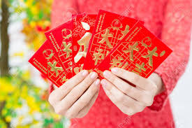 tet envelopes up of envelopes with money being presented