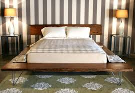 queen size wooden bed frame with vertical striped wall paint ideas