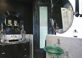 bathroom black round mirror with exclusive accessories for luxury