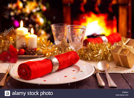 christmas dinner table setting a romantic christmas dinner table setting with candles and christmas