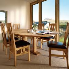 Round Dining Table Extends To Oval Furniture Kinship Expression With Round Dining Table Stylishoms