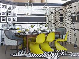 gray dining room with yellow panton chair and geometric pattern