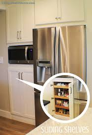 microwave pantry cabinet with microwave insert a built in microwave is located in the center of a tall pantry