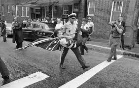 Confederate Flag Black And White Race Civil Rights And Photography A Police Officer Carrying Off