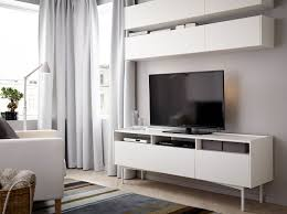 mueble salon ikea a living room with wall cabinets and a tv bench all in white