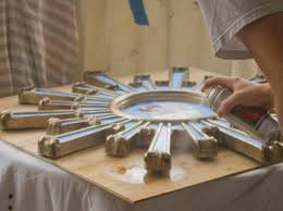 decorating gold sunburst mirror with cool table lamp and white