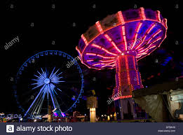 carousel and big wheel at the winter in hyde park stock