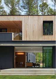this two story house has a central living room that can be fully