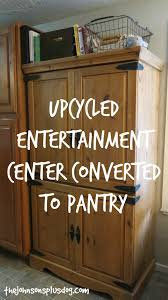 upcycled entertainment center converted to pantry pantry
