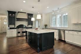 black island kitchen kitchen kitchen with white cabinets and black island breakfast bar
