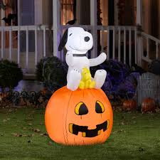 airblown inflatable snoopy on pumpkin by gemmy industries