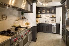 calacatta gold kitchen with full height splash dark grey cabinets