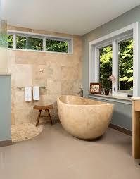 forest green master bath meadowlark design build master bath travertine tub with zero threshold shower in this ann arbor home
