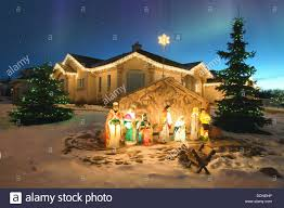 nativity outdoor outdoor christmas nativity with northern lights overhead stock