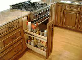 hidden shelves in narrow gap between the stove and cabinets to