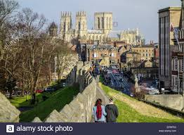 york city wall with station road and york minster in the distance