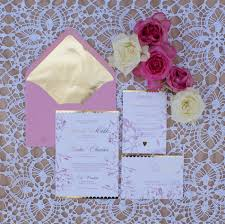 gold foil wedding invitation with blush pink watercolor design