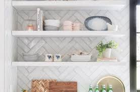 how to organize open kitchen cabinets how to attractively organize open shelves in the kitchen