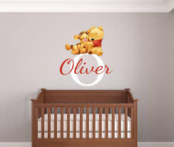 nursery wall stickers with custom names by eydecals personalised baby pooh and tigger name wall decal