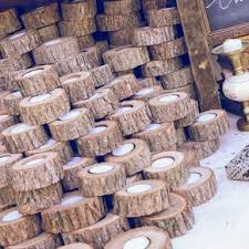 rustic bridal shower favors wedding favors cut logs with candle inside with raffia