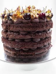 chocolate mudcake layers with red wine ganache fresh cherries