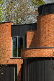 adrian james architects builds incurvo brick house