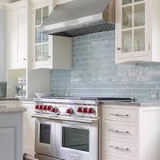 white kitchen cabinets with blue glazed subway tiles kitchen