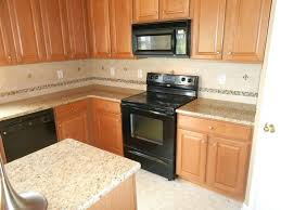light colored granite countertops lighting glamorous light granite countertops with oak cabinets