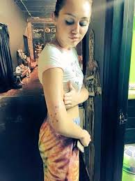 miley cyrus tattoos u0026 meanings a complete tat guide