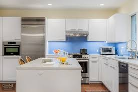 white shaker kitchen cabinets with gray quartz countertops cambridge contemporary modern leicht kitchen design