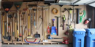 why think small install pegboard on an entire wall of your garage