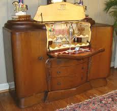 1930s art deco mini bar cabinet contrasting wood tones and
